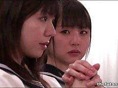 Cute Asian schoolgirls fool around in church