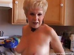 Very sexy grandma has a muddied wet pussy