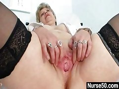 Big-chested granny in uniform stretching her aged pussy